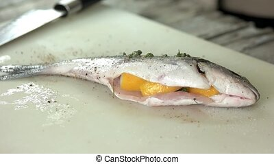 Dorado fish, salt and pepper. Uncooked food close up.