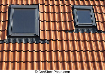 Dormers on a red tiled roof
