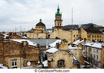 Dormition Church above the old houses in the center of Lviv, Ukraine in winter day.