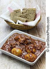 doro wat (spicy ethiopian chicken stew) and injera