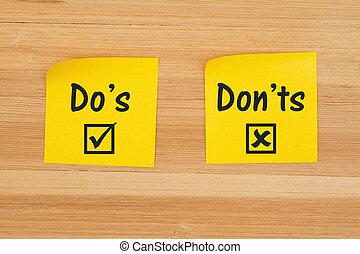 Do's and Don'ts on two sticky notes on textured wood desk - ...