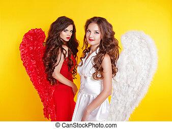dos, atractivo, mujeres, llevando, en, ángel traje, con, alas, aislar