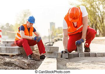 dos, constructores, en, interpretación el sitio