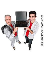 dos hombres, actuación, un, computadora de computadora portátil
