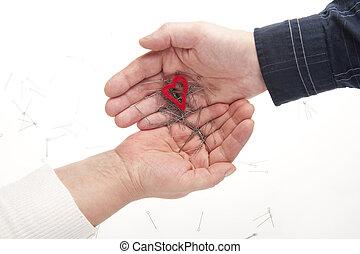dos manos, con, corazón, y, agujas