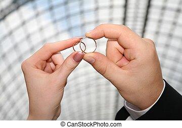dos manos, con, el, anillos