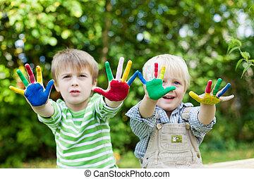 dos niños, tener diversión, y, actuación, colorido, manos