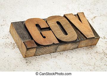 dot gov internet domain - network address for government- in vintage letterpress wood type on ceramic tile background