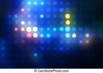 Dotted background of the colorful dots on the blured light