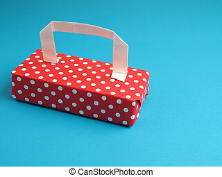 dotted gift with a handle on a blue background