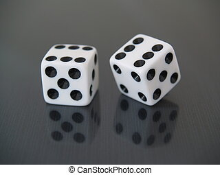 double 6 - two (2) white dice on black reflective background...