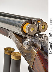 double barreled old shotgun charged - hunting vintage rifle...