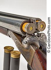 double barreled old shotgun charged - hunting vintage rifle...