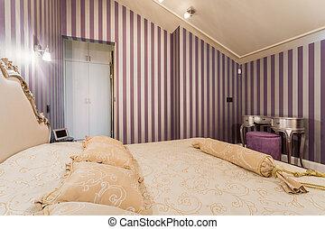 Double bed in baroque bedroom