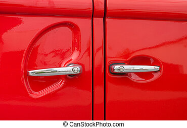 double car handles of a red vintage volkswagen bus