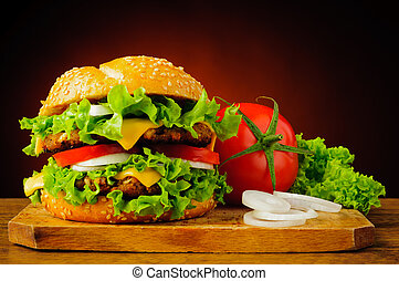 Double cheeseburger and fresh vegetables