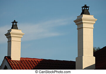 double chimney on top of an old house