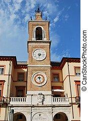 Double clock tower against blue sky, Rimini, Italy