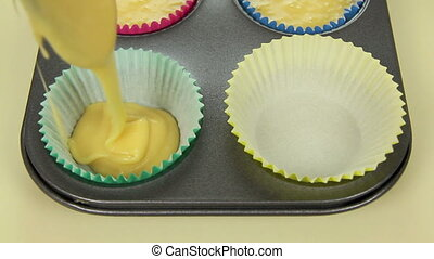 Double Cup Cake Fill - Filling two paper cups with cake mix...