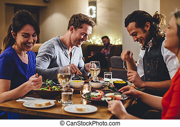 Double Date Dining - Group of friends enjoying an evening...