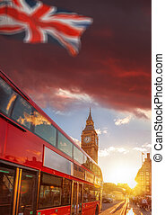 Double decker bus against Big Ben with colorful sunset in...