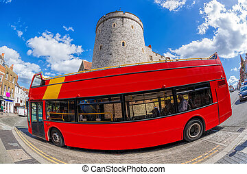 Double decker bus against Windsor castle in England, United Kingdom