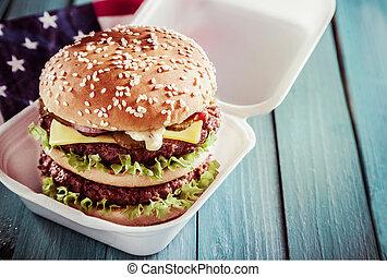 Double-decker cheeseburger on a sesame roll