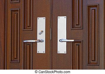 Double door handles - modern door handles on mahogany doors