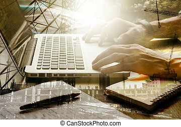 Double exposed of male hands working on laptop with the...