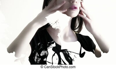 A woman holds her fingers over the face, neck, collarbone