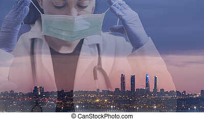 Double exposure of a doctor wearing a mask with the sky line in the background of the city of Madrid