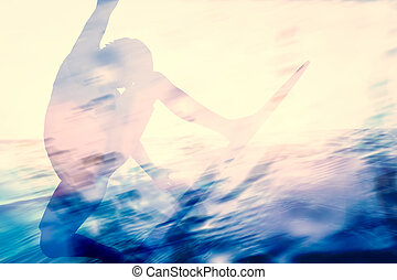 Double exposure of a surfer surfing in the ocean.