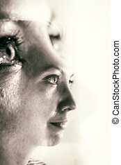 Double Exposure of a Woman's Face and Eyes in Monochrome