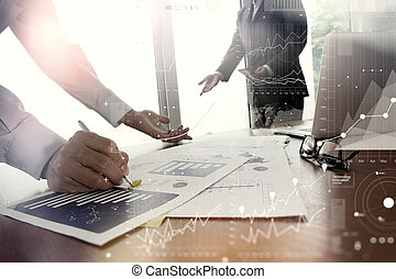 double exposure of business documents on office table with smart phone and digital tablet and stylus and two colleagues discussing data in the background