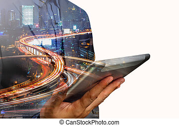 Double exposure of Business Man use Mobile Tablet with Urban...