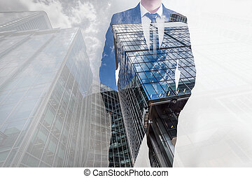 Double exposure of businessman and modern skyscrapers. Business leader, career concepts