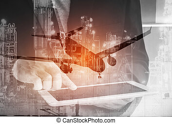 Double exposure of businessman hand hold tablet and oil...