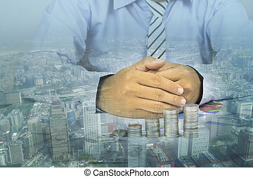 double exposure of businessman holding  hand  with city, concept as analyze and thinking to investment in business