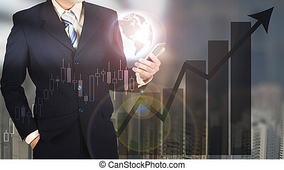 Double exposure of businessman holding smart phone and world with graph chart and blurred building background, Elements by NASA.