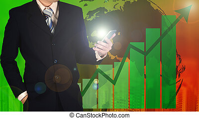 Double exposure of businessman holding smart phone with growth graph chart and blurred building background, Elements by NASA.