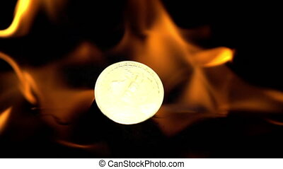 Double exposure of fire burning bit coin slow motion