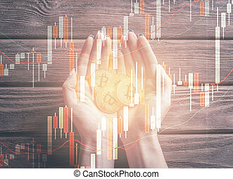 Double exposure of hands holding bitcoins with diagram.