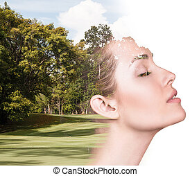 Double exposure portrait of attractive lady combined with photograph of forest