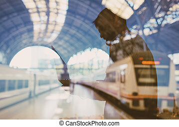 Double exposure of man on the train station