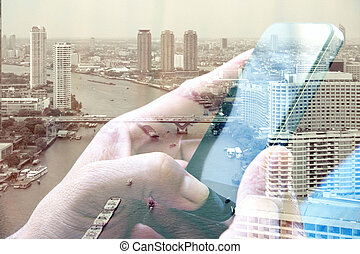 using smart phone and cityscape