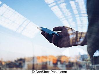 Double exposure of man's hand using smart phone