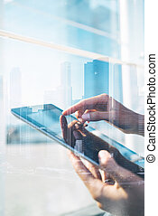 Double exposure of tablet - Double exposure of city and man...