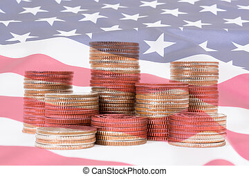 Double exposure of US. flag with stack of dollar coins use for financial concept