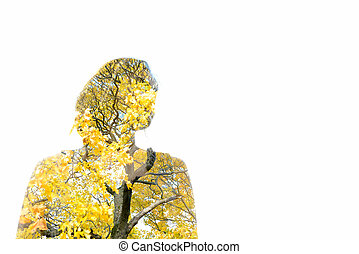 Double exposure of young woman and tree branches with autumn leaves
