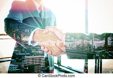 Double exposure people shaking hands with oil refinery...
